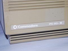 The logo of the Commodore PC 20-III computer.